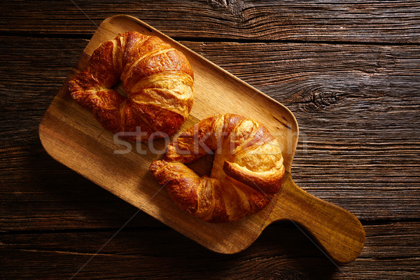 Croissants in wooden board Stock photo © lunamarina