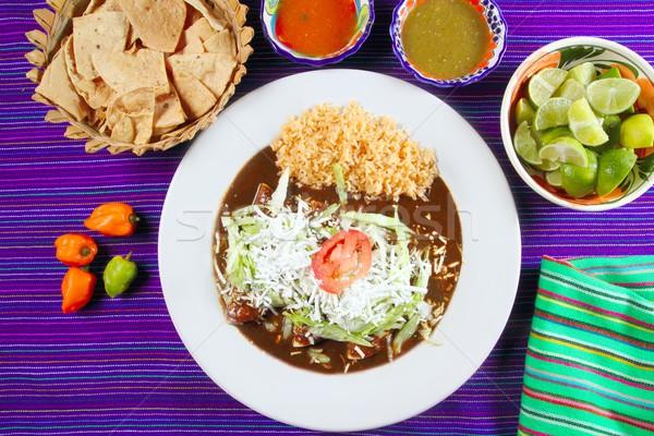 Mole enchiladas mexican food with chili sauces Stock photo © lunamarina