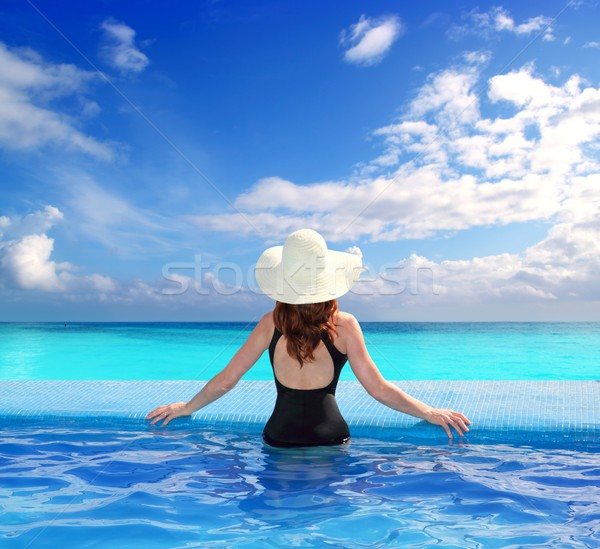 Stock photo: Caribbean sea view from blue pool rear woman
