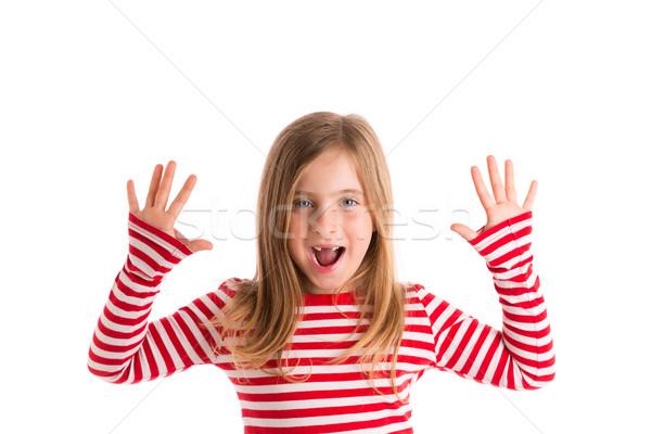 Blond indented kid open mounth hands happy Stock photo © lunamarina