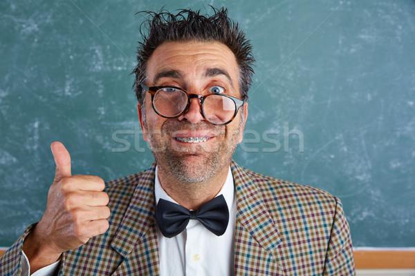 Nerd silly retro man with braces funny expression Stock photo © lunamarina
