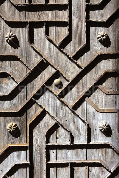 old aged wooden door iron handcraft deco Stock photo © lunamarina