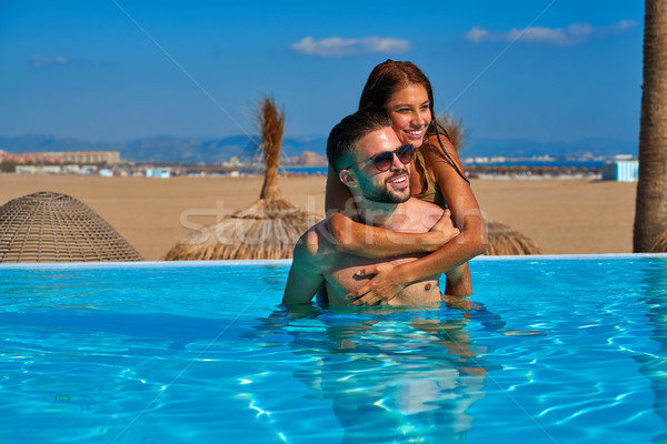 観光 カップル ピギーバック 無限 プール ビーチ ストックフォト © lunamarina