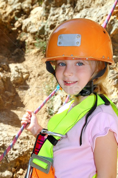 climbing little girl smiling portrait helmet rope Stock photo © lunamarina