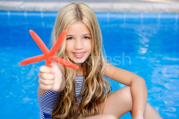 Crianças loiro menina férias de verão piscina starfish Foto stock © lunamarina