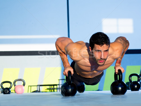 Gym man push-up strength pushup with Kettlebell  Stock photo © lunamarina