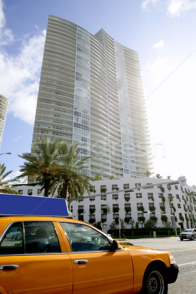 Yellow cab with Miami Beach Florida buildings Stock photo © lunamarina