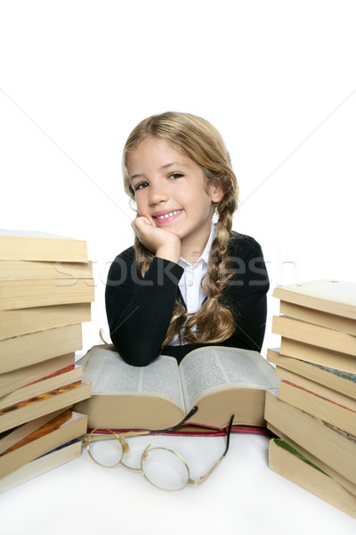 Stock photo: little student blond braided girl smiling with lots of stacked b