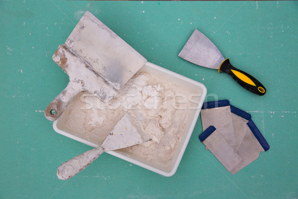 Platering tools for plaster like plaste trowel spatula Stock photo © lunamarina