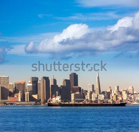 San francisco Skyline with merchant ship cruising bay at Califor Stock photo © lunamarina