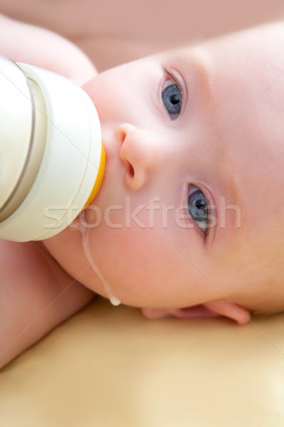 Bond little baby blue eyes drinking bottle milk Stock photo © lunamarina