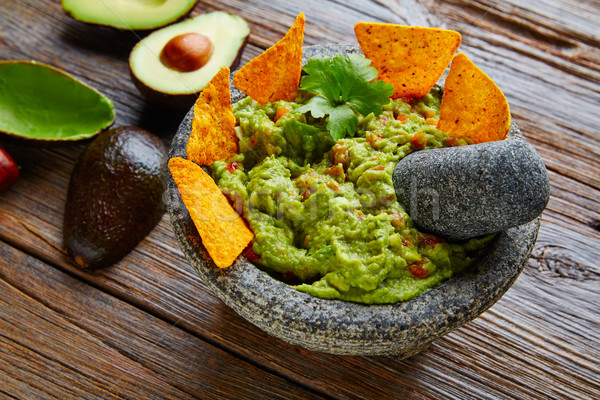 Guacamole with nachos in Mexican molcajete Stock photo © lunamarina