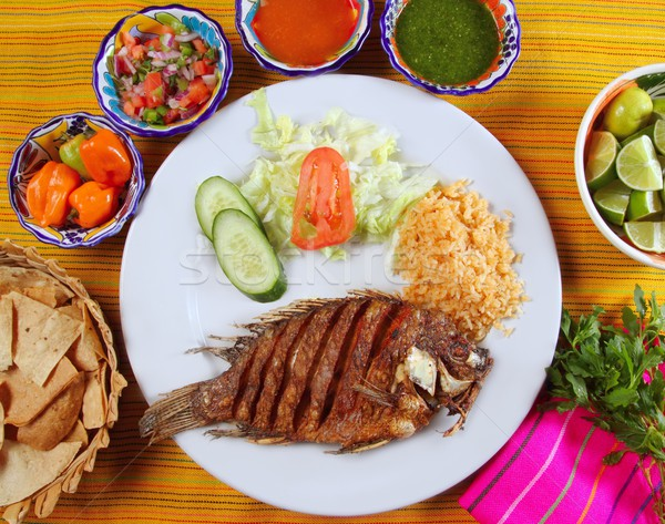 fried mojarra tilapia fish Mexico style with chili sauce Stock photo © lunamarina