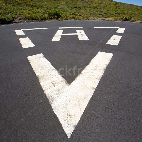 heliport triangle white soil painted sign Stock photo © lunamarina