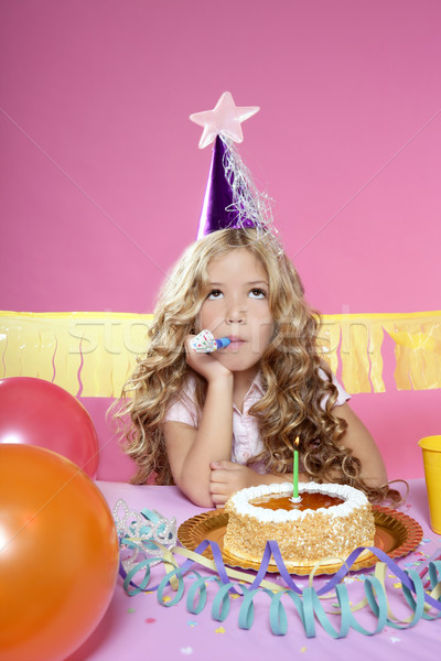 Stock photo: bored little blond girl birthday party with candle cake