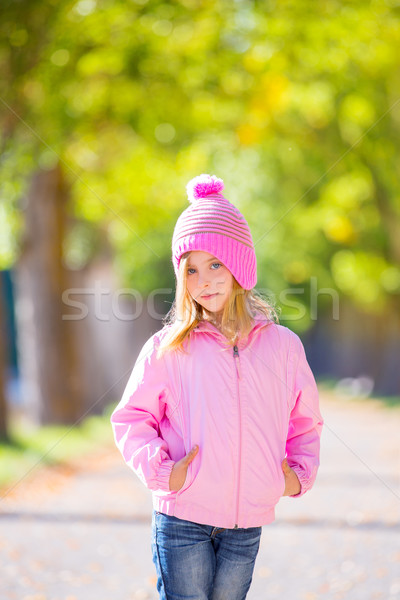 autumn winter kid girl blond with jeans and pink snow cap Stock photo © lunamarina