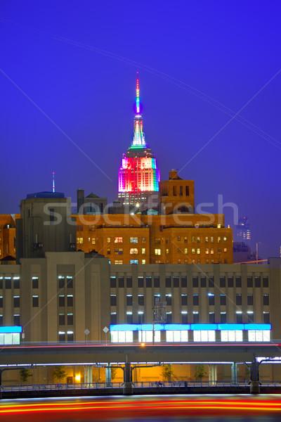 Manhattan sunset skyline New York Empire State Stock photo © lunamarina