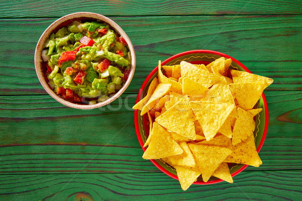Guacamole with avocado tomatoes and nachos Stock photo © lunamarina