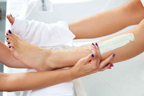 Aplying nourishing moisturizer mask woman legs Stock photo © lunamarina