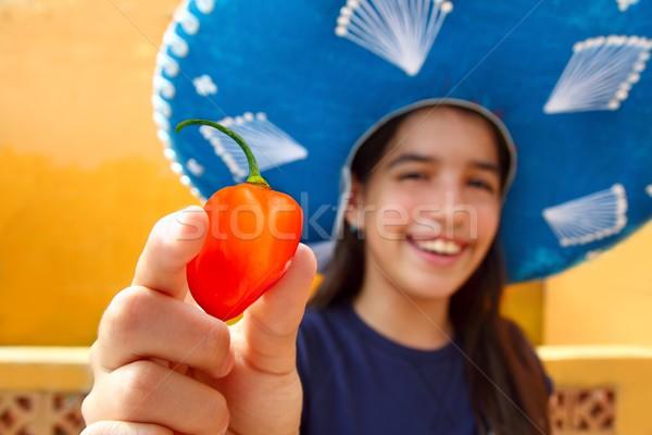 Mexican girl  habanero orange hot chili pepper Stock photo © lunamarina
