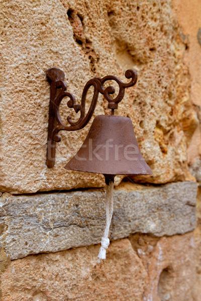 Rouillée fer peu cloche suspendu Photo stock © lunamarina