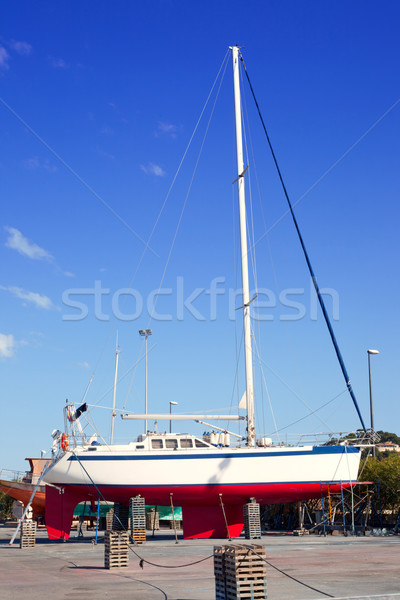 beached sailboat for the yearly hull paint Stock photo © lunamarina