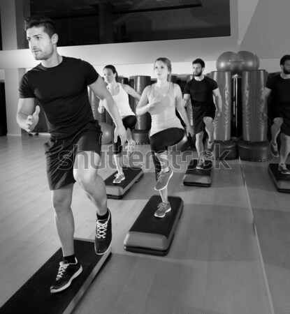 Stock photo: gym group with weight lifting bar crossfit workout