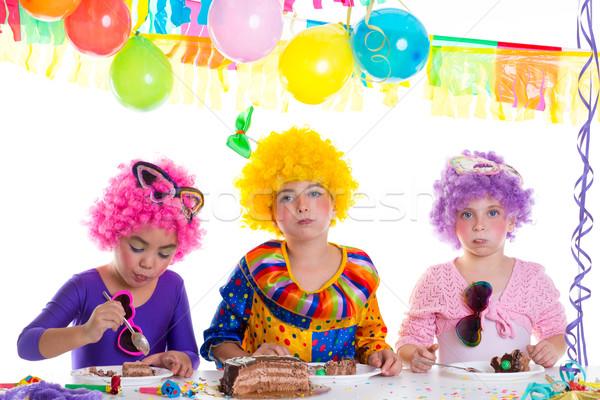 Children happy birthday party eating chocolate cake Stock photo © lunamarina
