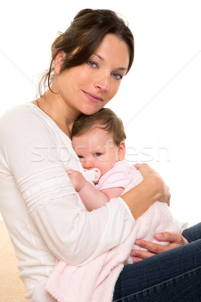 Baby girl relaxed with pacifier hug in mother arms Stock photo © lunamarina