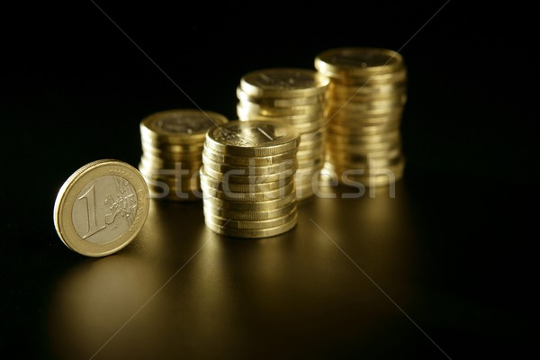 Euro currency coin columns with golden reflections Stock photo © lunamarina