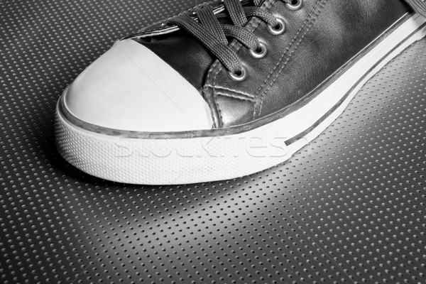 Silver sport shoe detail over gray steel Stock photo © lunamarina