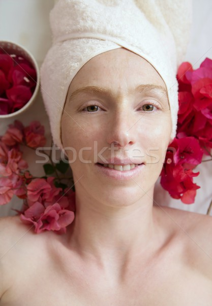 Spa flowers relaxing massage theraphy. Female thirty to fourty y Stock photo © lunamarina