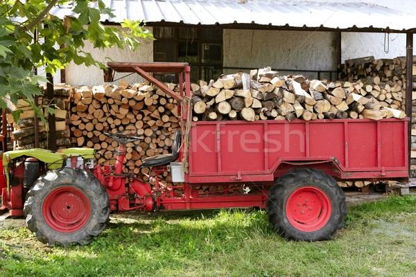 Firewood tractor in red color with stacked wood Stock photo © lunamarina