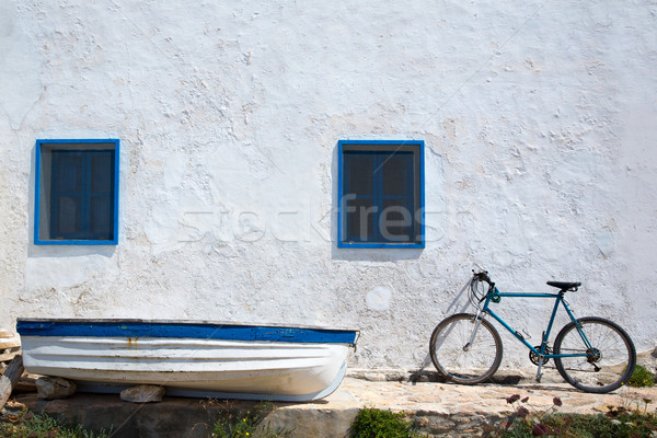 Mediterranean boat bicycle and white wall in white Stock photo © lunamarina