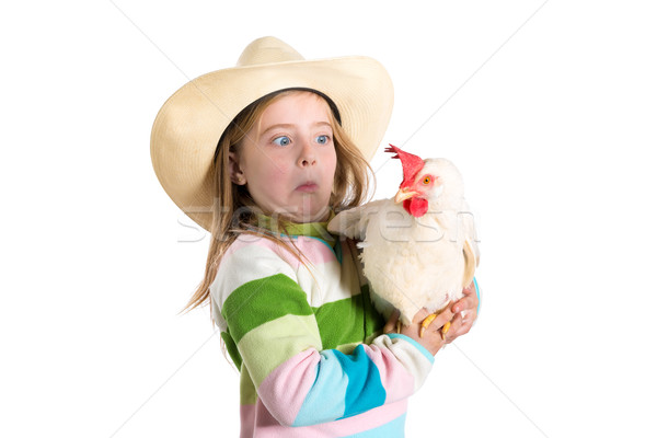 Funny kid girl expression surprised gesture scared of hen Stock photo © lunamarina