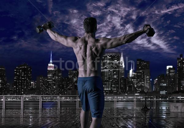 gym man rising hex dumbbells in New York city Stock photo © lunamarina