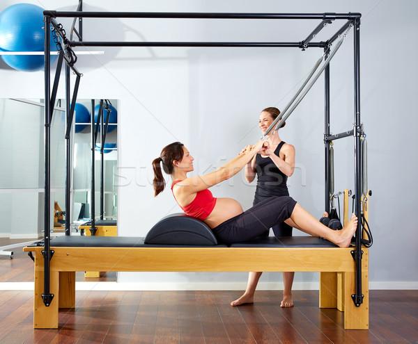 Terhes nő pilates zsemle felfelé testmozgás személyi edző Stock fotó © lunamarina