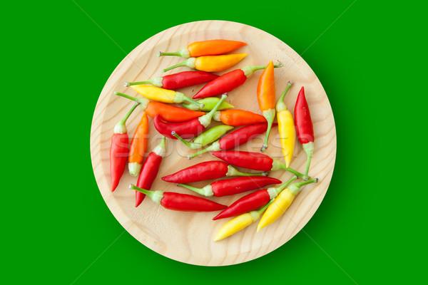 colorful chili peppers plate isolated Stock photo © lunamarina