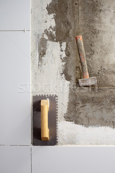 construction tools notched trowel and hammer Stock photo © lunamarina