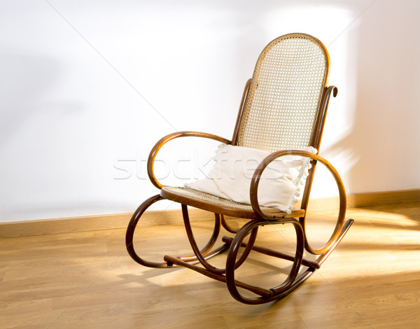 Golden retro rocker wooden swing chair on wood floor Stock photo © lunamarina