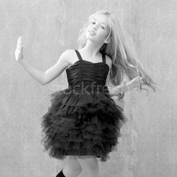 black dress kid girl dancing and twisting vintage Stock photo © lunamarina