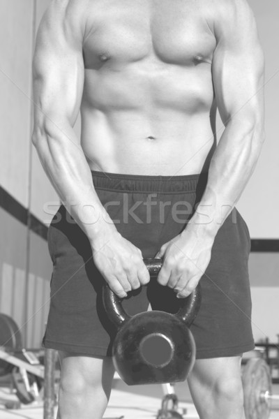 Crossfit Kettlebells swing exercise man workout Stock photo © lunamarina