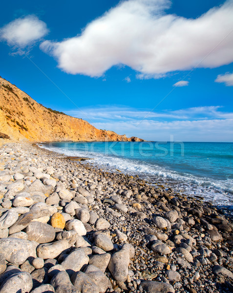 Ibiza Cala Jondal Beach with rolling stones in san Jose Stock photo © lunamarina