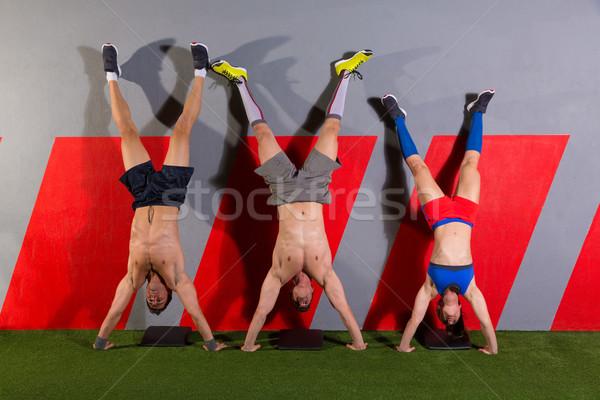 Handstand push-up group workout at gym Stock photo © lunamarina