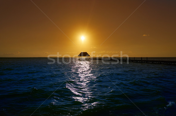 Holbox island sunset beach pier hut Mexico Stock photo © lunamarina