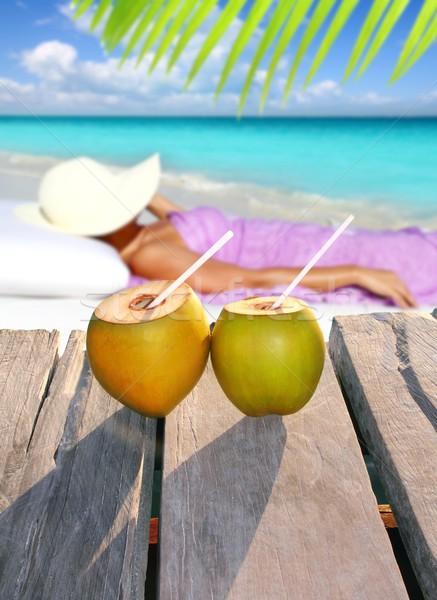 coconuts woman sun tanning topical beach Stock photo © lunamarina