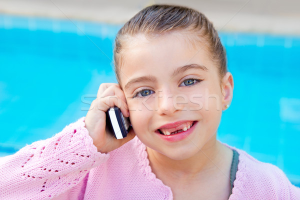 Stock photo: child little indented girl talking mobile phone