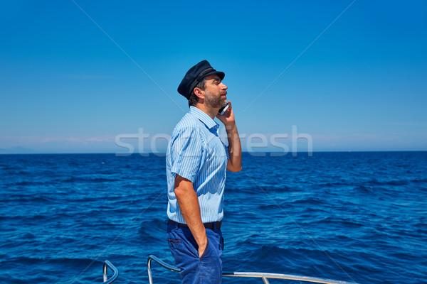 Captain cap sailor man talking mobile phone boat Stock photo © lunamarina