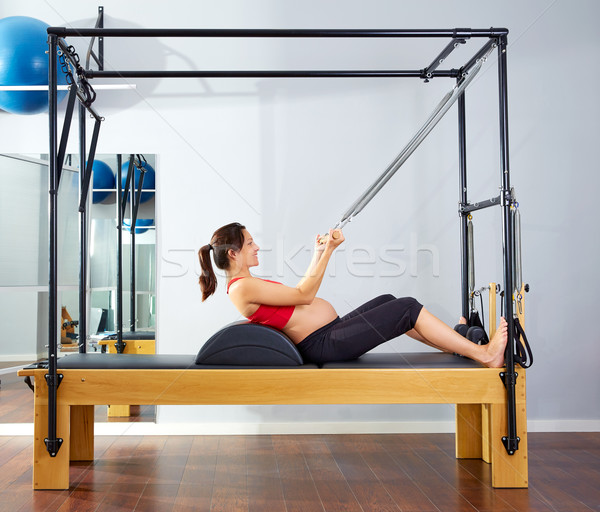 pregnant woman pilates reformer roll up exercise Stock photo © lunamarina