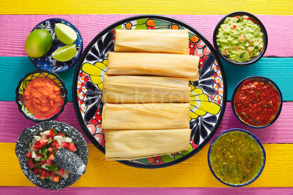 Tamale with corn leaf and sauces guacamole Stock photo © lunamarina
